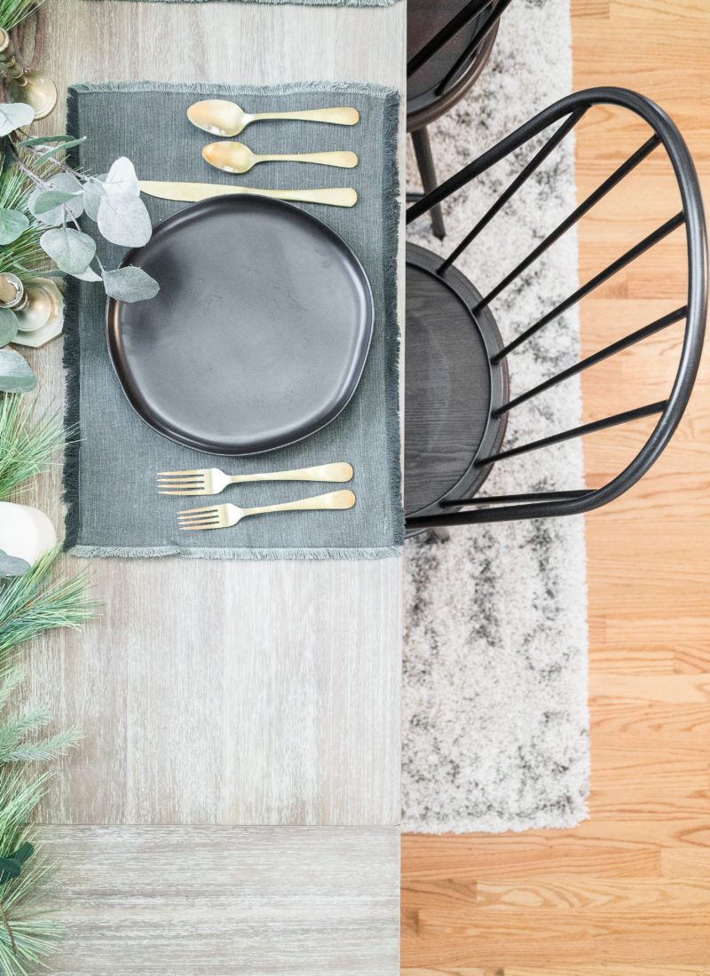 a beautiful holiday themed setting on a wooden farmhouse table